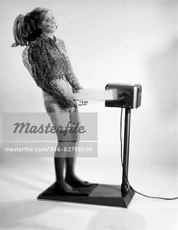 1960s WOMAN MASSAGED BY VIBRATING EXERCISE MACHINE Stock Photo - Rights-Managed, Image code: 846-02793094