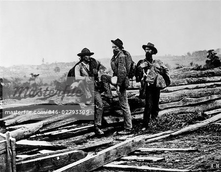 1860s CAPTURED MILITARY CONFEDERATE SOLDIERS SITTING PILE LOGS WOODEN RAILROAD TIES AMERICAN CIVIL WAR Stock Photo - Rights-Managed, Image code: 846-02793309