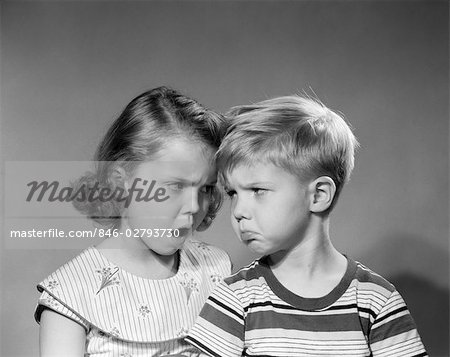 1950s BOY GIRL HEAD TO HEAD ANGRY FACIAL EXPRESSIONS ARGUMENT FIGHT Stock Photo - Rights-Managed, Image code: 846-02793730