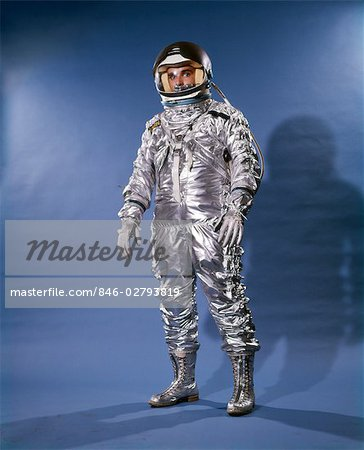 1960s MAN IN SILVER ASTRONAUT SPACE SUIT AND HELMET