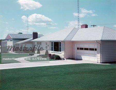 1950s SUBURBAN SINGLE FAMILY HOUSE DRIVEWAY GARAGE