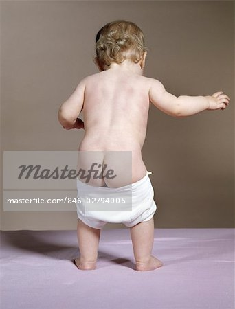 1960s BACK VIEW OF BABY WITH FALLING DOWN DIAPER SHOWING BABY'S BARE BOTTOM Stock Photo - Rights-Managed, Image code: 846-02794006