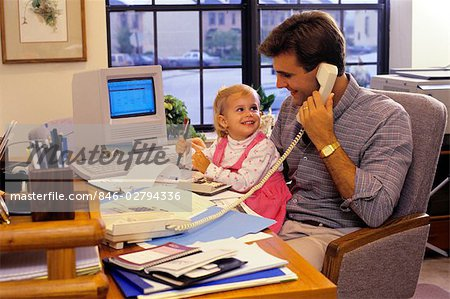 1990s FATHER WITH YOUNG DAUGHTER IN HOME OFFICE WITH APPLE MAC CLASSIC COMPUTER Stock Photo - Rights-Managed, Image code: 846-02794336