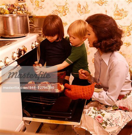 1970s WOMAN MOTHER CHILDREN SONS COOKING STOVE OVEN Stock Photo - Rights-Managed, Image code: 846-02794390