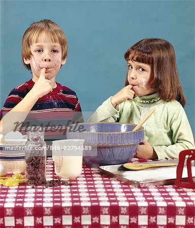 1970s RETRO BOY GIRL BROTHER SISTER MAKING COOKIES TASTING BATTER CHOCOLATE CHIPS BAKING COOKING Stock Photo - Rights-Managed, Image code: 846-02794589