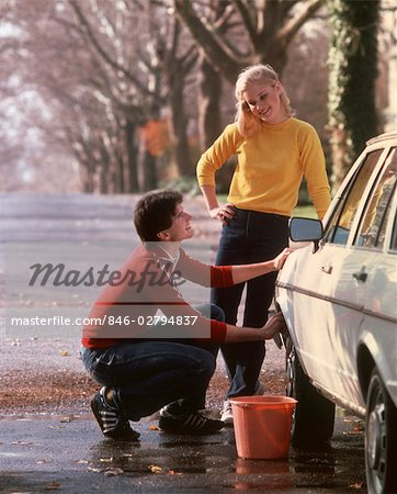 1970 1970s YOUNG COUPLE TEENS BOY GIRL MAN WOMAN WASHING CAR WASH AUTO 1980 1980s Stock Photo - Rights-Managed, Image code: 846-02794837