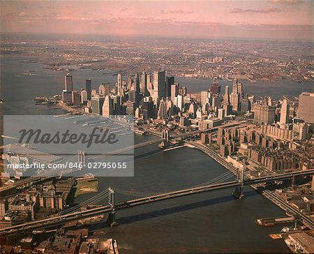 1970s AERIAL DOWNTOWN MANHATTAN LOOKING SOUTH BROOKLYN & MANHATTAN BRIDGE WORLD TRADE CENTER UNDER CONSTRUCTION Stock Photo - Rights-Managed, Image code: 846-02795055