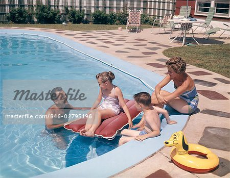 1960s 1970s RETRO FAMILY FATHER MOTHER SON DAUGHTER MAN WOMAN BOY GIRL TOGETHER IN BACKYARD SWIMMING POOL SMILING Stock Photo - Rights-Managed, Image code: 846-02795196
