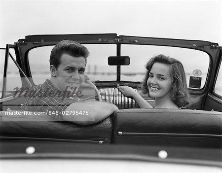 1950s CONVERTIBLE COUPLE MAN WOMAN DATE SMILE CAR