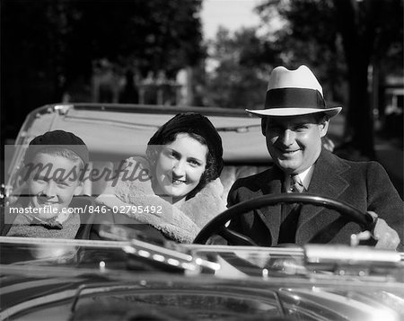 1930s SMILING FAMILY PORTRAIT MAN FATHER WOMAN MOTHER BOY SON RIDING IN CONVERTIBLE AUTOMOBILE Stock Photo - Rights-Managed, Image code: 846-02795492