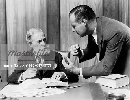 1930 1930s TWO MEN IN OFFICE AT DESK TALKING Stock Photo - Rights-Managed, Image code: 846-02795779