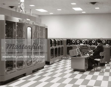 1950s MAN PROGRAMMER SITTING AT CONSOLE IN DATA PROCESSING ROOM WITH REMINGTON RAND UNIVAC COMPUTER AND TAPE DRIVES Stock Photo - Rights-Managed, Image code: 846-02795964