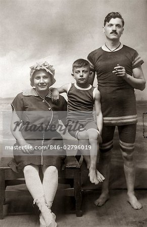 1890s 1900s FAMILY PHOTO PORTRAIT MOTHER FATHER CHILD BOY SON WEARING ANTIQUE BATHING SUITS IN SEASHORE STUDIO Stock Photo - Rights-Managed, Image code: 846-02796019