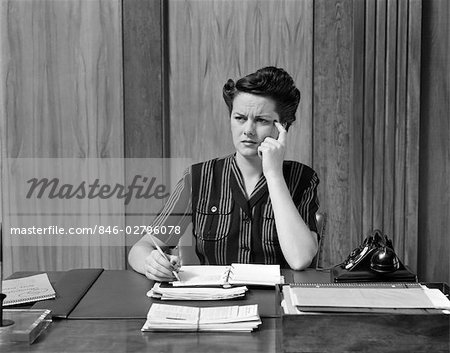 1940s WORRIED WOMAN BUSINESSWOMAN EXECUTIVE AT DESK THINKING Stock Photo - Rights-Managed, Image code: 846-02796078