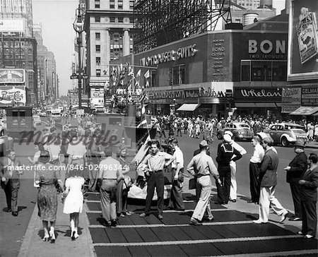 1940s WWII WARTIME TIMES SQUARE MANHATTAN PEDESTRIANS TRAFFIC TWO SAILORS NEAR MODEL OF NAVY SHIP RECRUITING STATION Stock Photo - Rights-Managed, Image code: 846-02796344