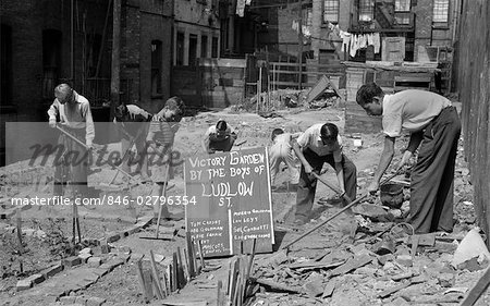 1940s BOYS WORKING IN WARTIME VICTORY GARDEN LUDLOW STREET NEW YORK CITY LOWER EAST SIDE MANHATTAN WWII Stock Photo - Rights-Managed, Image code: 846-02796354