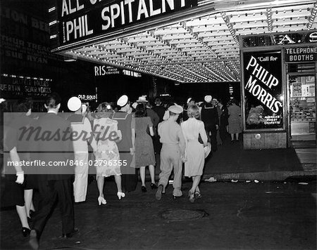 1940s NYC BROADWAY AT NIGHT MARQUEE OF MOVIE THEATER WITH SOLDIERS SAILORS AND WOMEN ON THE SIDEWALK OF WEST 51st STREET NEW YORK CITY USA Stock Photo - Rights-Managed, Image code: 846-02796355