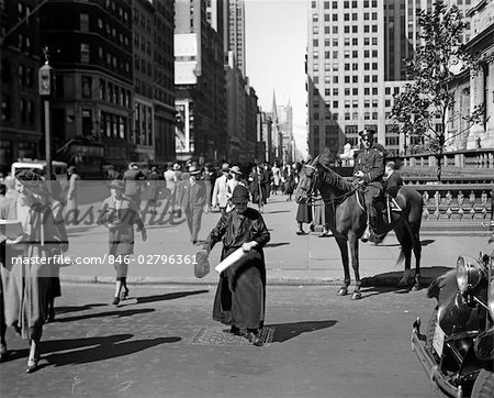 1930s MOUNTED POLICEMAN FIFTH AVENUE 40TH STREET WATCHES AS OLD WOMAN CROSSES THE STREET NEW YORK CITY USA Stock Photo - Rights-Managed, Image code: 846-02796361