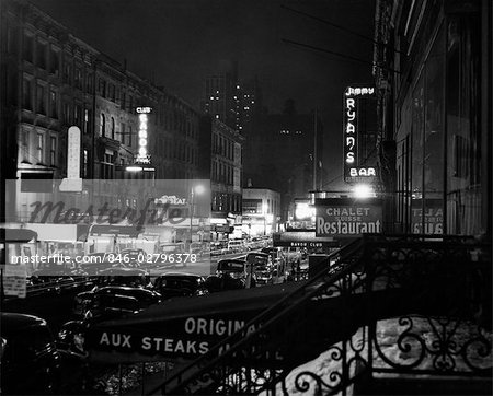 1930s 1940s NIGHT STREET SCENE NEW YORK CITY WEST 52nd STREET LIGHTS FROM NUMEROUS CLUBS AND NIGHTCLUBS Stock Photo - Rights-Managed, Image code: 846-02796378