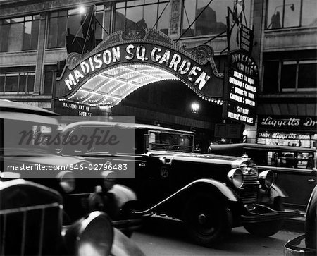 1920s 1930s CARS TAXI MADISON SQUARE GARDEN MARQUEE AT NIGHT HOCKEY NEW YORK CITY NYC LIGGETT DRUGSTORE MANHATTAN NY Stock Photo - Rights-Managed, Image code: 846-02796483