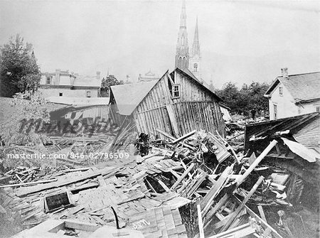MAY 31 1889 PHOTO RUINS WOODED BUILDINGS HOUSES DEBRIS FROM JOHNSTOWN FLOOD PENNSYLVANIA FLOODS DISASTER TRAGEDY DEVASTATION Stock Photo - Rights-Managed, Image code: 846-02796509