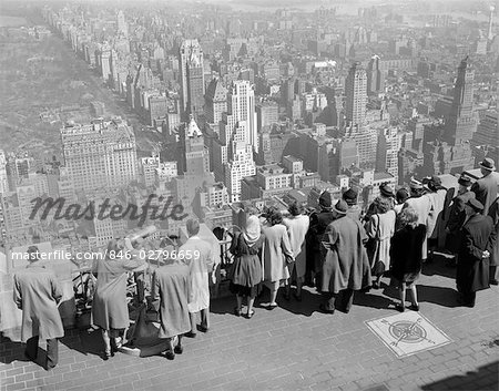 1940s GROUP OF TOURISTS STANDING ON TOP OF RCA BUILDING LOOKING OUT OVER CITY Stock Photo - Rights-Managed, Image code: 846-02796659