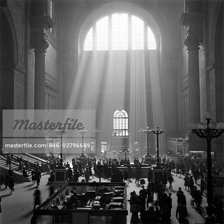 1940s INTERIOR PENNSYLVANIA STATION NEW YORK CITY WITH SUN RAYS STREAMING IN WINDOW Stock Photo - Rights-Managed, Image code: 846-02796689
