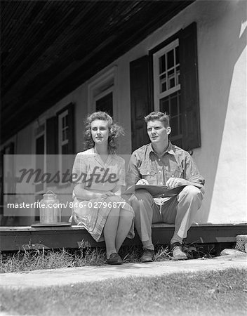 1940s COUPLE MAN WOMAN SITTING PORCH FARM HOUSE LOOKING OFF TO SIDE LEDGER BOOK MAN'S LAP SMALL MILK CONTAINER WOMAN PLAID DRESS Stock Photo - Rights-Managed, Image code: 846-02796877
