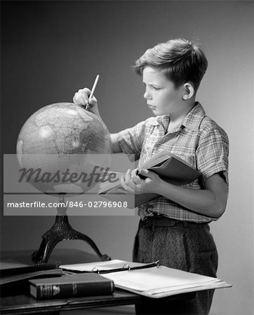 1940s 1950s SERIOUS BOY FINDING LOCATION ON WORLD EARTH GLOBE WITH PENCIL HOLD OPEN BOOK GEOGRAPHY Stock Photo - Rights-Managed, Image code: 846-02796908