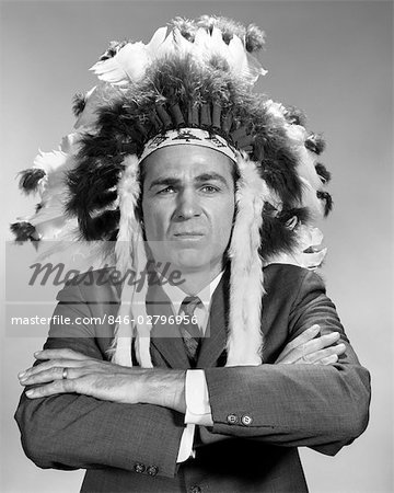 1960s PORTRAIT MAN WEARING INDIAN CHIEF FEATHERED HEADDRESS Stock Photo - Rights-Managed, Image code: 846-02796956