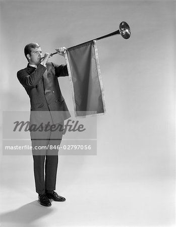 1960s YOUNG MAN STANDING BLOWING HERALD'S HORN Stock Photo - Rights-Managed, Image code: 846-02797056