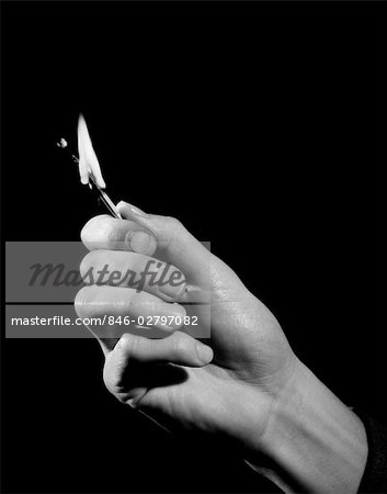 1950s MAN'S HAND HOLDING OUT WOODEN MATCH STICK BURNT ALMOST DOWN TO FINGERS Stock Photo - Rights-Managed, Image code: 846-02797082