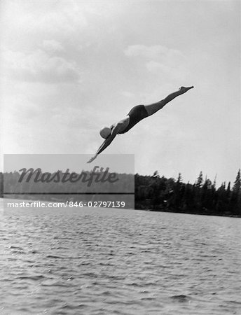 1930s WOMAN DIVING INTO LAKE Stock Photo - Rights-Managed, Image code: 846-02797139