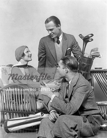 1930s TWO MEN ONE WOMAN GOLF CLUBS AND BAG SMILING TALKING SITTING BAMBOO CHAIR MAN SMOKING PIPE Stock Photo - Rights-Managed, Image code: 846-02797242