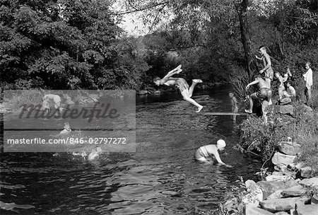1950s BOYS GIRLS GROUP SWIMMING IN CREEK STREAM POND SUMMER FUN JUMP SPLASH DIVE RETRO VINTAGE SWIM SWIMMING HOLE