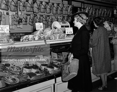1940s WOMEN IN BUTCHER SHOP AT DISPLAY CASE OF MEATS Stock Photo - Rights-Managed, Image code: 846-02797282