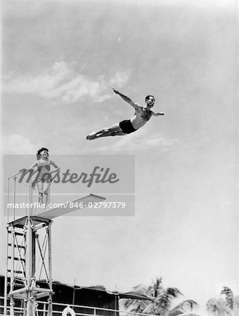 1940s MAN SWAN DIVING OFF HIGH DIVING BOARD WOMAN WATCHING Stock Photo - Rights-Managed, Image code: 846-02797379