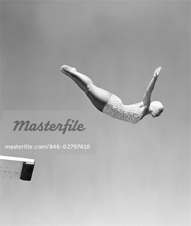 1950s WOMAN SWAN DIVE OFF DIVING BOARD ONE PIECE BATHING SUIT CAP Stock Photo - Rights-Managed, Image code: 846-02797410
