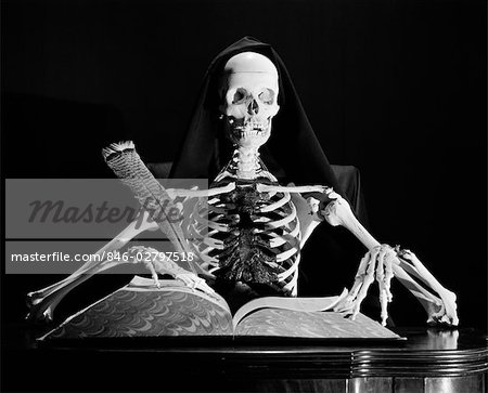 STILL LIFE OF SKELETON WRITING IN LARGE BOOK WITH QUILL PEN Stock Photo - Rights-Managed, Image code: 846-02797518