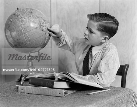 1940s YOUNG BOY STUDYING WITH BOOKS AND WORLD GLOBE Stock Photo - Rights-Managed, Image code: 846-02797525