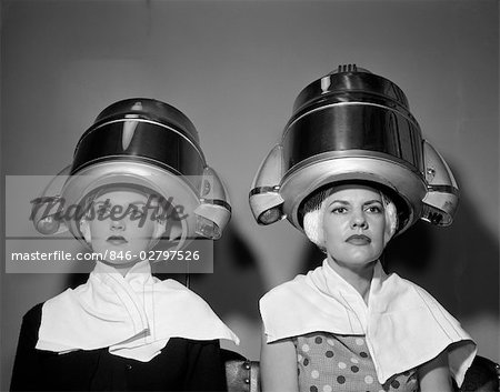 1950s TWO WOMEN UNDER HAIR DRYERS TOWELS AROUND SHOULDERS HAIR NETS Stock Photo - Rights-Managed, Image code: 846-02797526