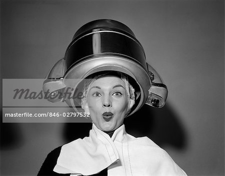 1950s WOMAN UNDER HAIR DRYER WITH TOWEL ON SHOULDERS AND HAIR NET Stock Photo - Rights-Managed, Image code: 846-02797532