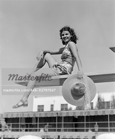 1930s 1940s WOMAN HOLDING HAT POSING DIVING BOARD SWIM SUIT POOL TRAVEL VACATION SWIMMING HOTEL MIAMI FLORIDA Stock Photo - Rights-Managed, Image code: 846-02797567