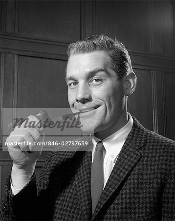 1950s PORTRAIT OF MAN IN TWEED JACKET SMOKING PIPE SMILING INDOOR Stock Photo - Rights-Managed, Image code: 846-02797639