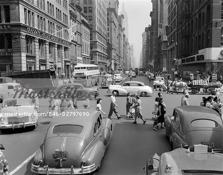 1940s 1950s STREET SCENE CROWDS TRAFFIC INTERSECTION FIFTH AVENUE & 14 STREET MANHATTAN NY NEW YORK CITY Stock Photo - Rights-Managed, Image code: 846-02797690