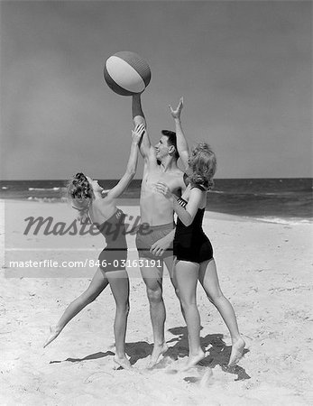 1950s TEENS JUMPING FOR BEACH BALL WEARING SWIM SUITS Stock Photo - Rights-Managed, Image code: 846-03163191