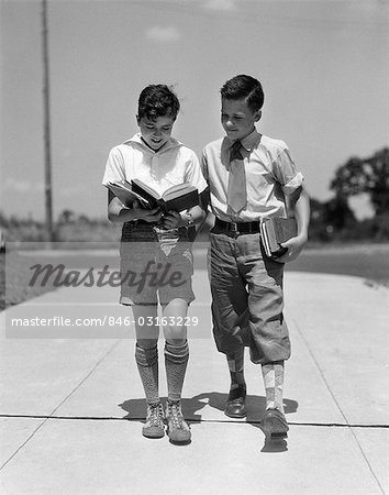1930s TWO BOYS WALKING SCHOOL READING BOOKS Stock Photo - Rights-Managed, Image code: 846-03163229