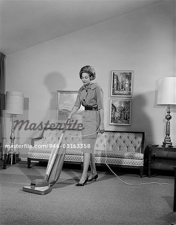 1960s WOMAN VACUUM HOUSEWORK CHORE HOUSEWIFE Stock Photo - Rights-Managed, Image code: 846-03163358