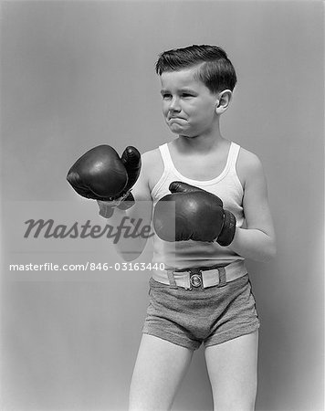 1940s CHILD WEARING BOXING GLOVES STANDING Stock Photo - Rights-Managed, Image code: 846-03163440