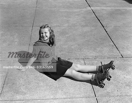 1940s CHILD SITTING ON GROUND WEARING ROLLER-SKATES Stock Photo - Rights-Managed, Image code: 846-03163559